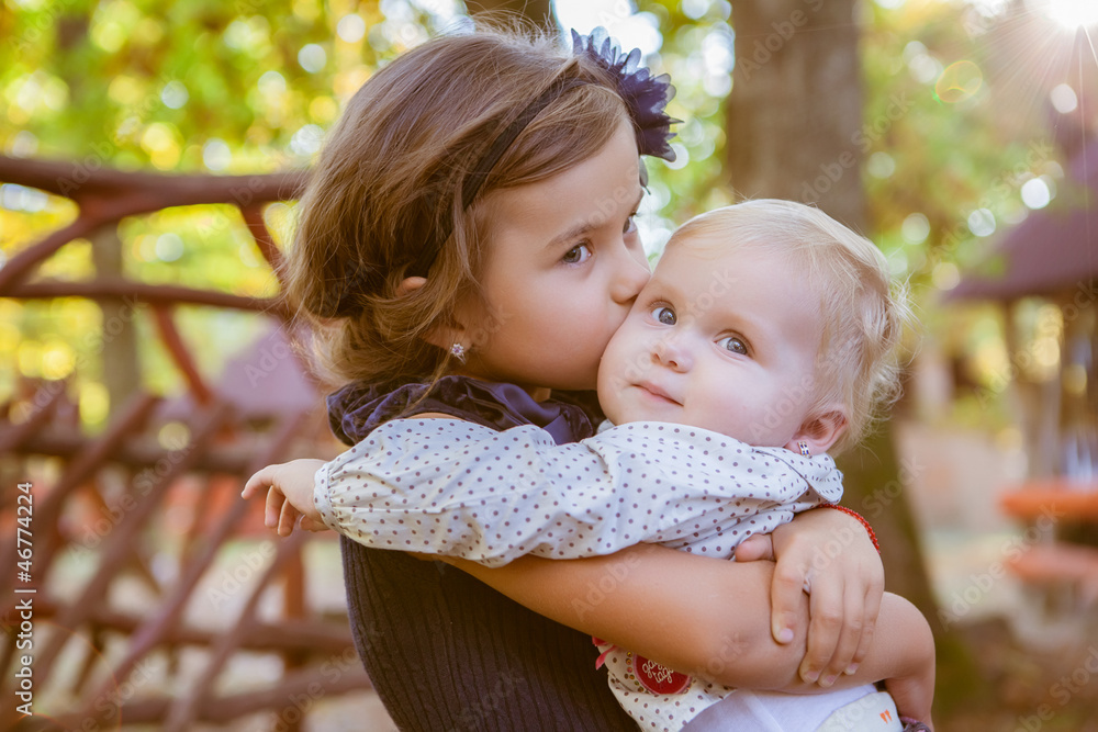 Fototapety, obrazy: little beautiful sisters in autumn park