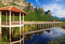 Wooden Bridge In Lotus Lake At...