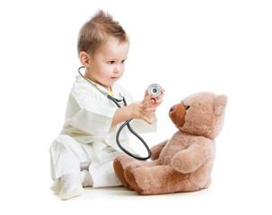 Fototapeta samoprzylepna kid or child playing doctor with stethoscope and teddy bear isol