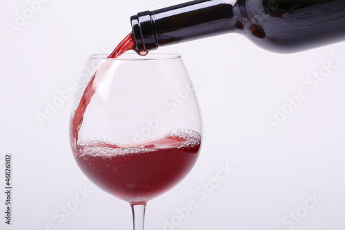 Fotografie, Obraz  Young red wine is poured into a glass