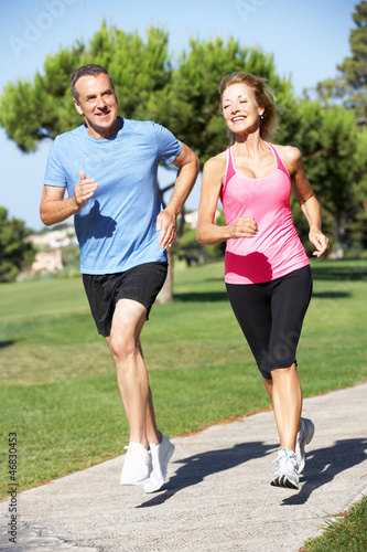 Poster Jogging Senior Couple Exercising In Park