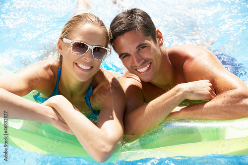 Couple Having Fun In Swimming Pool Canvas Print