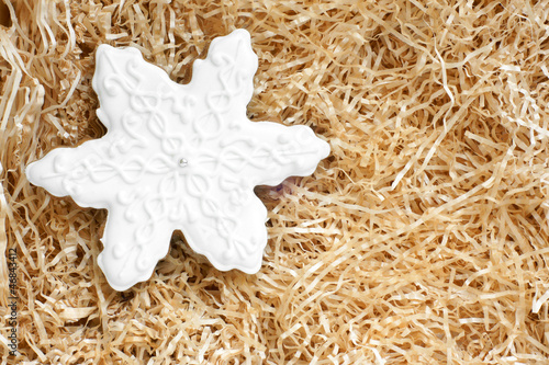 Fotografia, Obraz  Christmas gingerbread cookie made in the shape of a snowflake