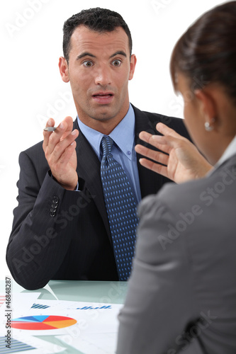 businessman and businesswoman having a discussion Canvas Print