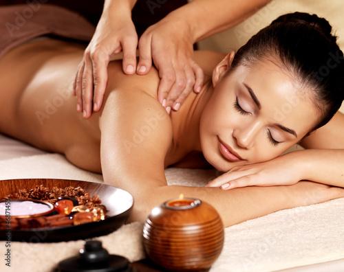 Fototapety, obrazy: Woman having massage in the spa salon