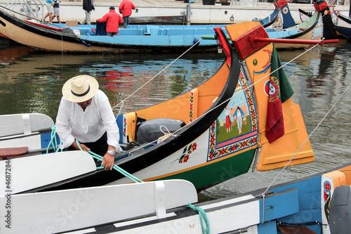 Portuguese sailor mooring traditional moliceiro boat in Aveiro, Canvas Print