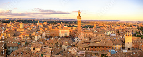 Fototapeta Siena sunset panoramic skyline. Mangia tower landmark. Tuscany,