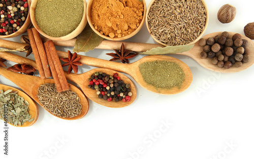 Staande foto Kruiden 2 wooden bowls and spoons with spices isolated on white