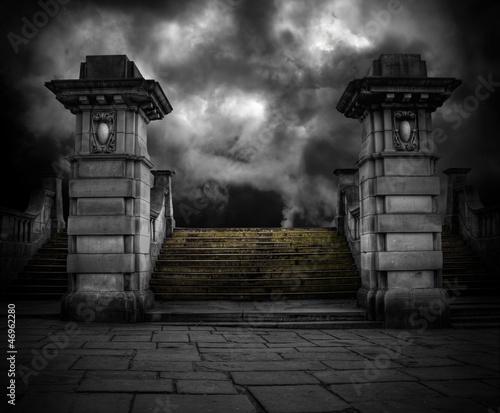 Photo Spooky old sandstone graveyard entrance