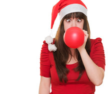 Christmas Woman Blowing A Ball...