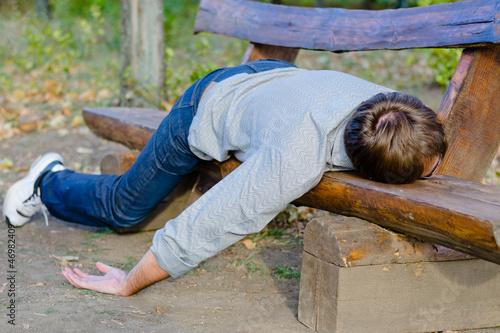 Fotografie, Obraz  Drunk man sleeping in park