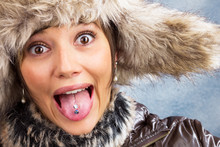 Funny Pretty Woman With Fur Hat Joking, Winter Portrait