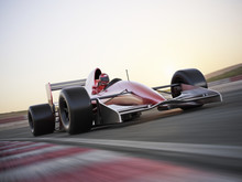 Indy Car Racer With Blurred Ba...