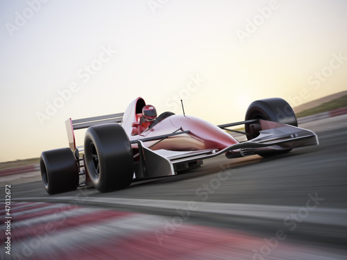 Indy car racer with blurred background Poster