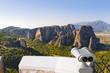 Binoculars and Meteora monastery in Greece