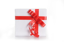 Gift Box With Red Tape On Whit...