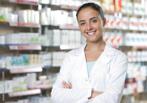 Tuinposter Apotheek Portrait of Smiling Woman Pharmacist in Pharmacy