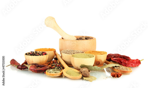 wooden mortar, bowls and spoons with spices isolated on white