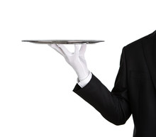 Waiter Holding Empty Silver Tr...