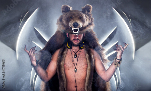 Fotografie, Tablou  Scary man in a bear coat with scar