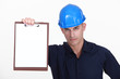 craftsman holding clipboard