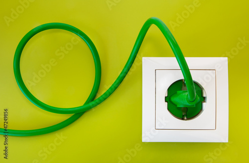 Fotografía  Green power plug into white power socket