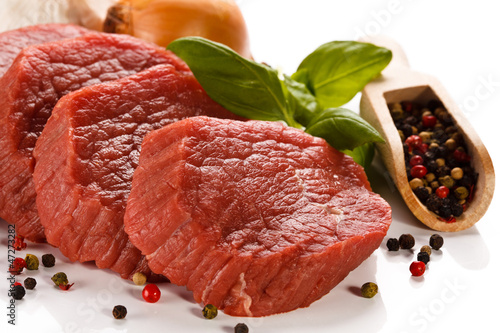 Staande foto Vlees Raw beef and vegetables on white background
