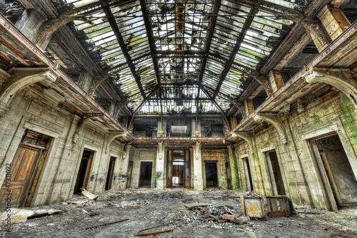 Beautiful glass roof inside the hall of an abandoned central off