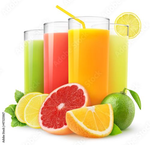 Isolated drinks. Glasses of fresh citrus juices (orange, grapefruit, lemon, lime) and cut fruits isolated on white background
