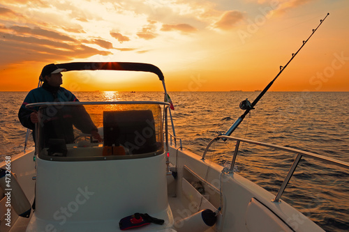 modern fishing boat at sunrise