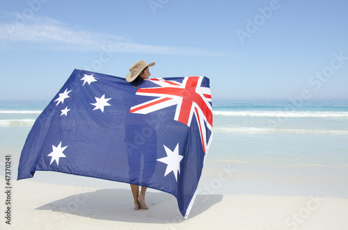 Attractive woman Australian flag at ocean beach Canvas Print