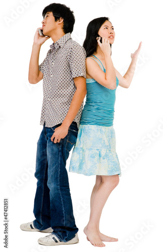 Girlfriend and boyfriend talking on mobile Poster
