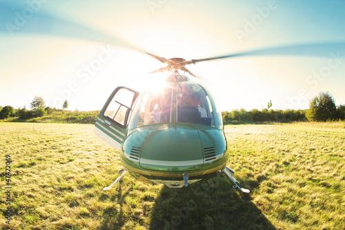 Poster Helicopter Startklarer Hubschrauber im Gegenlicht