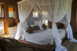 canvas print picture - Four-poster bed in an African lodge
