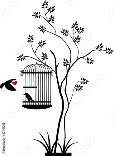 In de dag Vogels in kooien flying bird silhouette with a love for birds in the cage