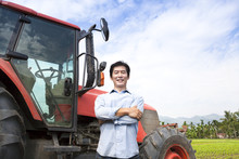 Happy Middle Aged Asian Farmer...