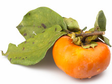 Orange Persimmon With Leaves Isolated On White Background