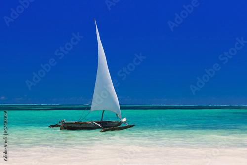 Poster Zanzibar wooden boat in crisp blue water