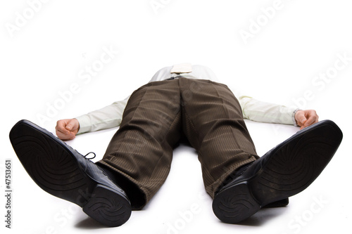 Photo  Young businessman lying on the floor