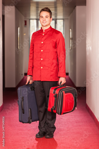 Fotografie, Obraz  Bellboy with Luggages in the Hallway