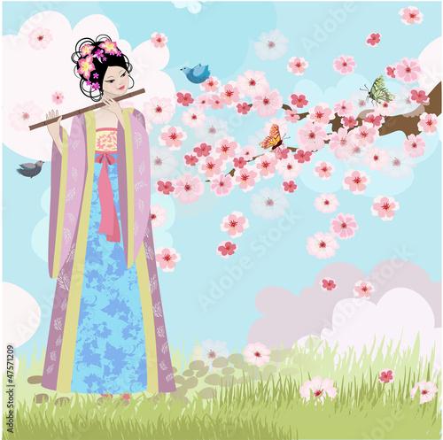 Fotobehang Bloemen vrouw Beautiful Oriental girl near cherry blossoms
