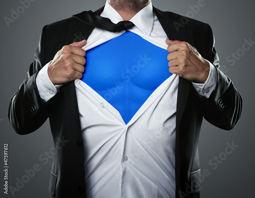 Fototapeta Young businessman acting like a super hero obraz