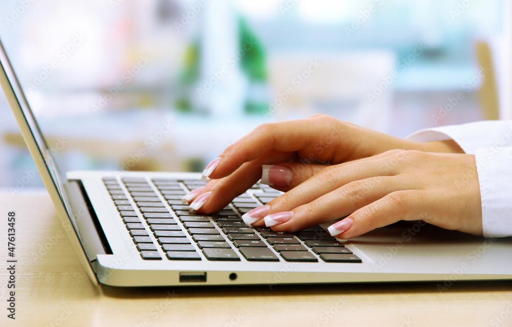 female hands writing on laptot, close up - obrazy, fototapety, plakaty