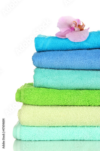 Fotografie, Obraz  Stack of towels with fragrant flower isolated on white
