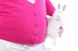 Leinwandbild Motiv Toy rabbit with unreal design touches belly of pregnant woman