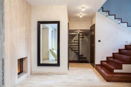 Obraz Travertine house: mirror and stairs - fototapety do salonu
