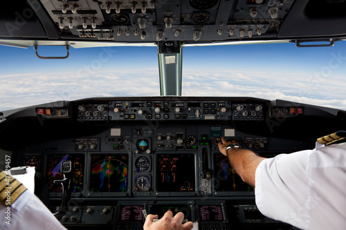Fotografie, Obraz  Pilots Working in an Aeroplane During a Commercial Flight