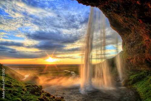 Cascades Seljalandfoss waterfall at sunset in HDR, Iceland