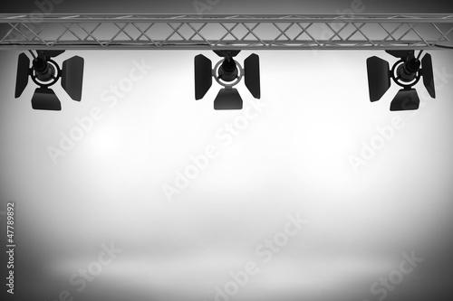 Foto op Canvas Licht, schaduw Spotlights illuminating a stage