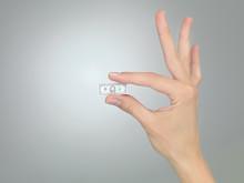 Hand With Tiny Dollar Bill